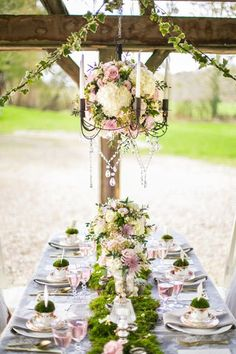 Enchanted forest theme. Flower chandelier, ivy garland and moss table runner. Dusky pink and cream wedding flowers. Floral Design by Boutique Blooms: Photo credit: Anneli Marinovich Photography