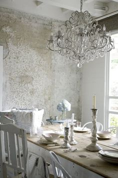 Distressed wall, chandelier, abundance of natural light ~