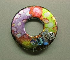 Tim Holtz alcohol inks, alcohol blending solution, wire, beads, zinc plated washer (from the home improvement store)