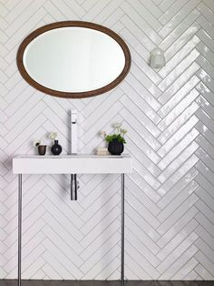 Chevron Tile Pattern White Gloss Tiles with A Chevron Pattern are Ideal for Any Bathroom White Bathroom Tiles, Downstairs Bathroom, Bathroom Wall, Bathroom Interior, Wooden Bathroom, Budget Bathroom, Wall Tile, Master Bathroom, Chevron Bathroom