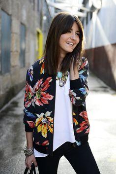 Floral cardigan brings a splash of color.