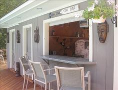 Bar built into detached garage - this is exactly what we've been talking about doing on our garage, overlooking the pool