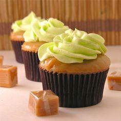 These #caramel cupcakes are dipped in a gooey caramel sauce, then topped with tangy green #apple frosting! #yum
