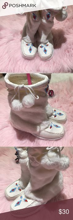 😍 Flurry fluffy white faux fur boots 😍 Flurry fluffy white faux fur boots. Warm lining. Beaded design & puff balls 😍. Size 9. Wore once. Has a couple small marks / scuffs . Not too noticeable when worn. Check pics for reference. Shoes Winter & Rain Boots