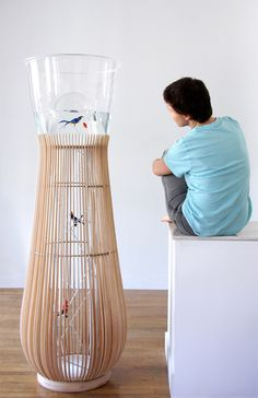 """Duplex is an aquarium/cage favouring an improbable encounter between a bird and a fish. The aquarium is thermoformed so as to create a space where the bird can fly at the same visual level as the fish."" Extract from Constance Guisset"