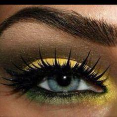 I'm liking this yellow makeup. Striking!