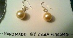 $17.00  http://www.etsy.com/listing/86172719/classic-pearl-dangles