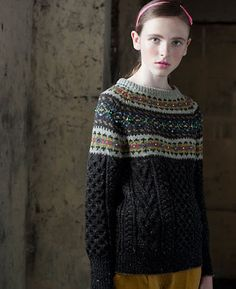 Dark colors, fair isle yoked jumper.