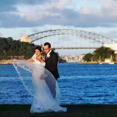 Our stunning bride Nancy with her new husband. This is an amazing photo framed by the Sydney Harbour Bridge. #marrymebridal #wedding #weddingday #weddinggown #weddingdress #weddingideas #weddinginspiration #weddingphotography #bride #bridal #married #happycouple #happilyeverafter #sydney #instalove #instabride #inspiration #outdoors #outdoorwedding #nature #sydneyharbour #harbour #sydneyharbourbridge #australia #blue #veil #wind #water #boats #love by marrymebridal_ http://ift.tt/1NRMbNv