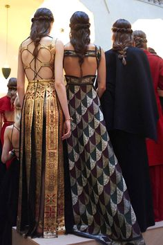 Rolled back twist side-hair accessorized with golden headband tiaras with a messy loose low braid hairstyle backstage details at Valentino Mirabilia Romae Fall Winter 2015 Haute Couture PFW FW15 HC
