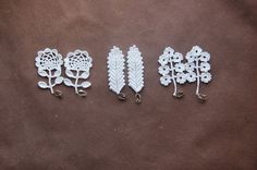 Crochet lace earring 2  (leaves and flowers) by Nadya Petrova on Flickr