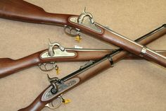 The Pedersoli company markets replica blackpowder rifles under its own name. Newest to the company's lineup are several rifles commemorating the American Civil War. Shown from the top are a CSA Richmond Rifle, a Springfield, and an Enfield. The Davide Pedersoli company is one of several, fine Italian gunmakers located in Gardone Val Trompia that provide many of the products for Cimarron Firearms.