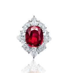 A CARAT BURMESE RUBY AND DIAMOND RING. Centering upon a cushion-shaped ruby weighing carats, within a pear-and marquise-shaped diamond surround, mounted in white gold, ring size 4 Unique Diamond Rings, Ruby Diamond Rings, Diamond Jewelry, Burmese Ruby, Platinum Engagement Rings, Red Jewelry, Bridal Ring Sets, Beautiful Rings, Beautiful Women