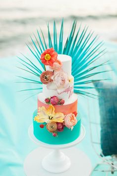 Tropical wedding cake bursting with color, by MJB Cakes.