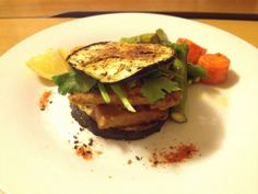 Eggplant burger...I replaced the beef pattie with tempeh which is a soy-based alternative . Simple satay sauce to go along with the tempeh and oven-raosted veggies!