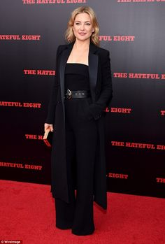 She's a looker! Kate Hudson, 36, epitomized red carpet style as she arrived for the premiere of The Hateful Eight in an off-the-shoulder black jumpsuit with flared bottoms and a matching tailored coat