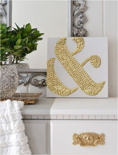 gold tack ampersand-this is so cool! Love the gold and white contrast and you could create anything