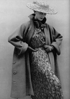 Model in yellow and black silk print dress worn with mustard wool coat by Robert Piguet, photo by Philippe Pottier, 1951