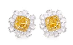 A PAIR OF 2.15 & 2.26 CARATS FANCY INTENSEYELLOW DIAMOND AND DIAMOND EARRINGS. Each centring upon a cushion-shaped fancy intense yellow diamond, weighing approximately 2.15 carats and 2.26 carats respectively, surrounded by a rose-cut diamond surround, mounted in 18K gold.