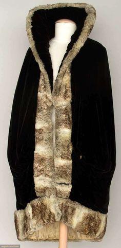 VELVET & CHINCHILLA OPERA CAPE, 1910-1920 Black velvet coccoon shape, deep shawl collar, gray chinchilla trim, cream silk lining. Front