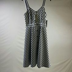 """Eva Mendes Black and White Stripe dress --- NWT Brand new with tags.  A line black and white striped dress with button detail. Beautiful easy """"wash and wear"""" fabric. New York & Company Dresses Midi"""
