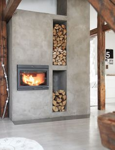 concrete-fireplace-with-firewood-storage - Home Decorating Trends - Homedit Home Fireplace, Home, Modern Interior, House Design, Fireplace Design, Interior, New Homes, Concrete Fireplace, House Interior