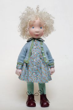 (Price above is merely an indication)  An AC doll is one-of-a-kind handcrafted doll.  Her head is carefully sculpted from wool (no mould used).
