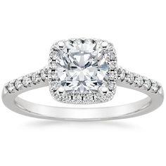 The Sonora Halo Diamond Ring with a cushion-cut center diamond.