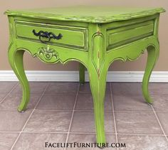 Ornate Curvy End Table in Lime Green with Black Glaze, with distressing revealing white primer. Original vintage pull. From Facelift Furniture's End Tables collection.