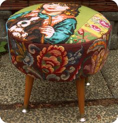 Floral and dog needlepoint footstool.
