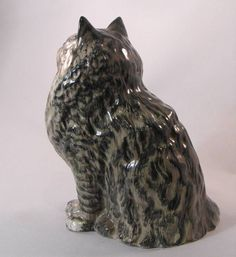 Beswick Persian cat sitting , grey Swiss roll colourway . Model number 1880