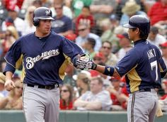 Milwaukee Brewers' Mat Gamel, right, celebrates with Norichika Aoki after scoring on a hit by Jonathan Lucroy.