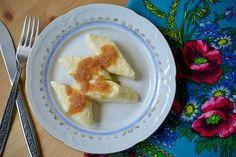 Pierogi leniwe [pierogi leh-knee-veh] are a simple mixture of tangy farmer's cheese* with flour and eggs. They are a simple Polish dumpling, that does not require making stuffing, neatly roll…