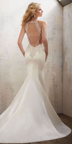 This Elegant Fit & Flare Wedding Gown Features Beautiful Diamant Beaded Embroidery on Duchess Satin. A Breathtaking Back with Chandelier Straps Completes the Look.