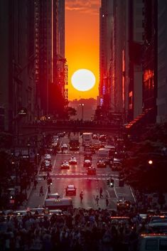 A beautiful Manhattanhenge shot by newyorkcityfeelings.com - The Best Photos and Videos of New York City including the Statue of Liberty Brooklyn Bridge Central Park Empire State Building Chrysler Building and other popular New York places and attractions.
