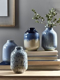Each with a different design, including plain, ombre speckled and striated, our set of four bold blue bud vases will add a pop of statement blue to your living space. Use to display petite buds or floral sprays, or leave unfilled for a more mi