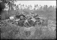 Airmen of the RAF Regiment man a captured German Spandau machine gun in a foxhole near Eindhoven, The Netherlands.  They are, (left to right); Corporal J Wilkins of Middlesborough, Leading Aircraftmen H Clay of Watford, and Leading Aircraftmen D Freed of Birmingham.