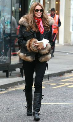 Elle Macpherson fought the London chills in a fur-trim biker while on the school run in London. The bear-like fur and a cute neck scarf dressed up her otherwise edgy all-black look. www.pertlybeast.com