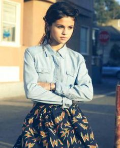 Selena Gomez wearing a denim button up and a skater skirt