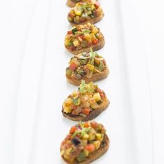 Ratatouille, a hearty, warming vegetable stew. To serve as an hors d'oeuvre, place the ratatouille atop crostini. Or see here for more ideas for using ratatouille to create yummy crostini appetizers: http://www.usatoday.com/experience/weekend/food/chef-bill-three-ways-to-enjoy-ratatouille/13729797/