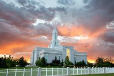 The Mount Timpanogos Utah Temple at sunset, including the grounds.