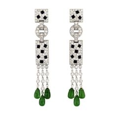 Cartier Panther Onyx Emerald Diamond White Gold Earrings | From a unique collection of vintage drop earrings at http://www.1stdibs.com/jewelry/earrings/drop-earrings/