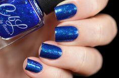 Colors by llarowe Holiday 2016 - Ho, Ho, Ho, It's Santa LaRowe - Purchase the full 8 set CbL Holiday 2016 Collection and receive this fabulous topper polish as a free bonus! This is a sheer bright blue multichrome flakie polish. Layer it over a complementary colour to embellish your manicure. Shown here layered over Caribbean Holiday by @tanya_wish on Instagram.