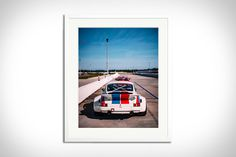 In 2019, the iconic blue and red striped livery of the Jacksonville, Florida-based Brumos was brought out of retirement. This shot of the rear of... James Bond, Fuji, Porsche 911, Frame Sizes, Red Stripes, Order Prints, Solid Wood, Objects, Photos