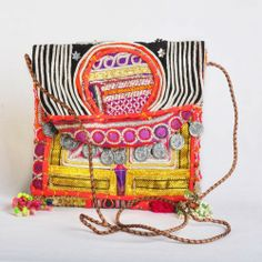 Vintage Afghani fabrics are repurposed in to sling bags. So COOL!