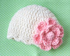 crochet baby hat with a big flower