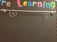 magnetic curtain rod for anchor chart hanging/storage - blog post said she found it at walmart