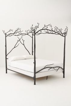 Dream bed frame! Forest Canopy Bed - Anthropologie.com #bedframe #forest #branches #enchantedforest #theme #home #decor #artsy #creative #inspiring #dreamhome #obsessed #anthropologie