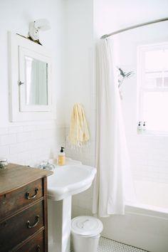 clean and bright - vintage dresser as vanity/bathroom storage, cute trashcan
