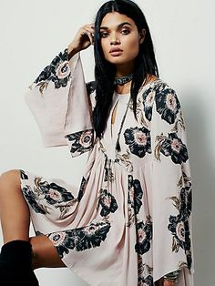 Poppy Fields Forever Dress | Equal parts whimsical and playful, this dress features a swingy silhouette with keyhole openings at the back and bust. Exaggerated wide sleeves. Sheer fabrication and full slip included.